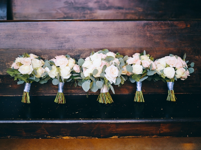 hand tied bridesmaids bouquets blue ribbon greenery