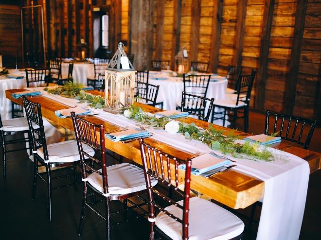 farm table white runner lantern centerpiece big sky barn wedding civic photos