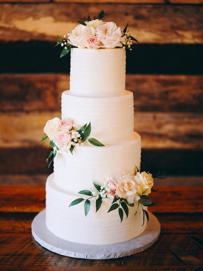 simple white tiered wedding cake fresh flowers big sky barn texas civic photos