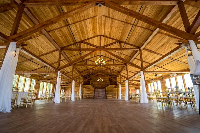 rustic wedding venue, elegant, indoor reception space, natural light, windows