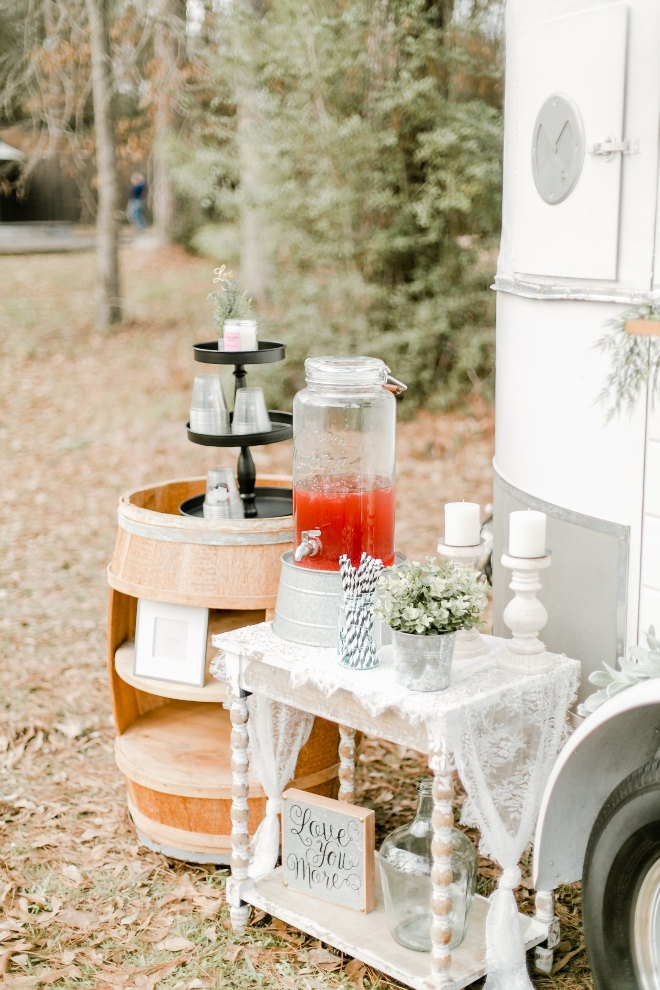 bar cart vintage beverage dispenser striped straws outdoors natural light wedding photography amy maddox