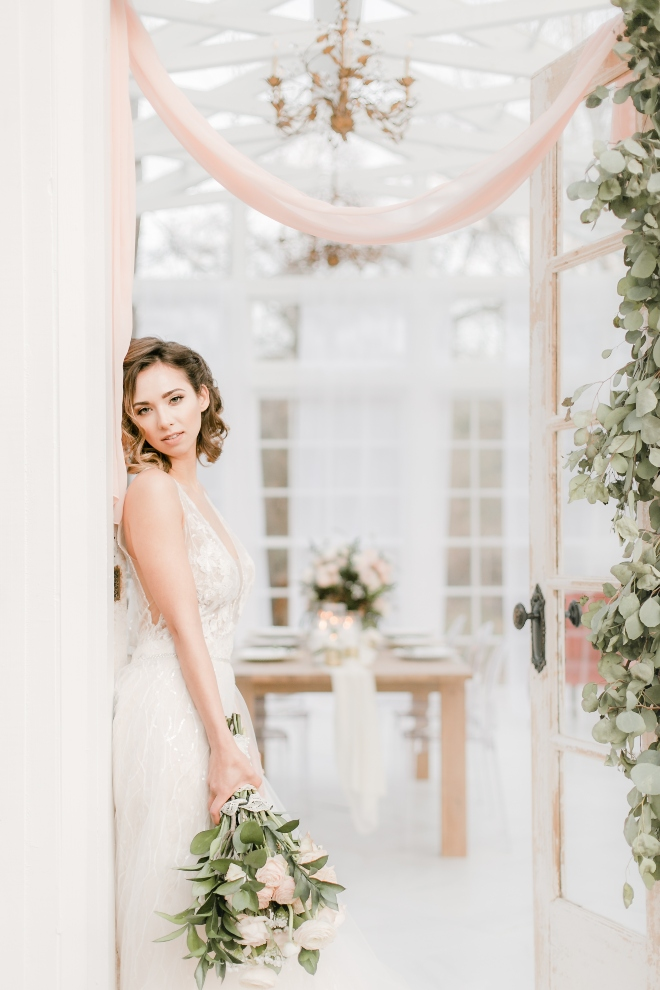 bride portrait natural curls doorway chiffon swagging glass conservatory parvani vida gown natural light wedding photography amy maddox