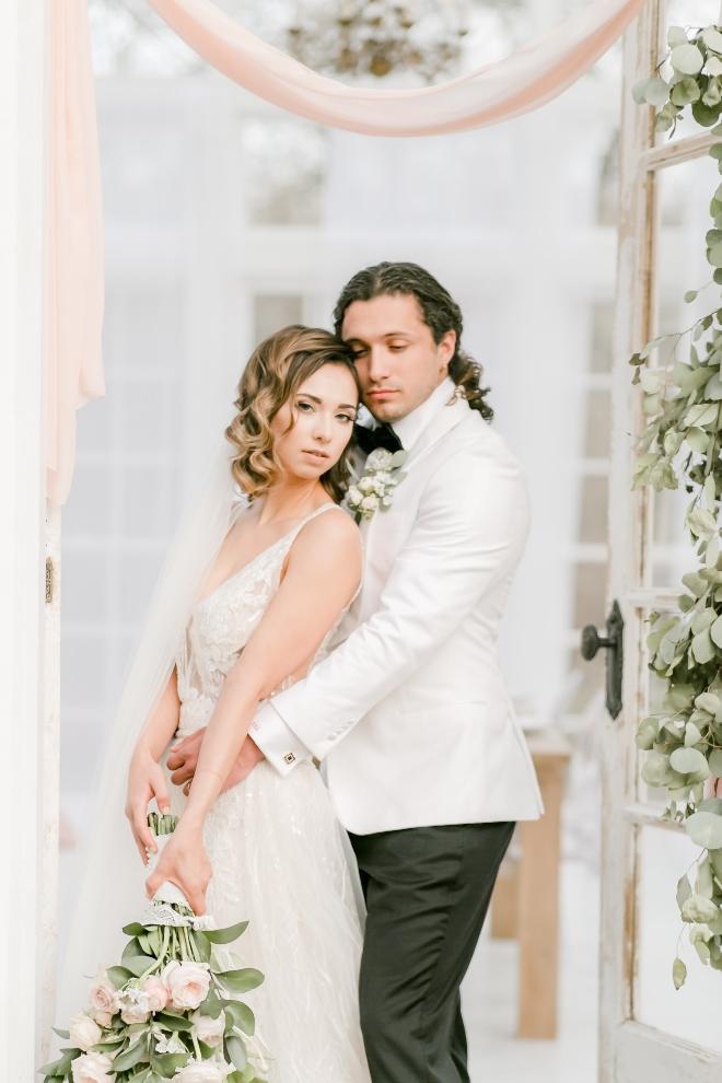 bride groom portrait doorway reception entrance parvani vida dress natural light wedding photography amy maddox