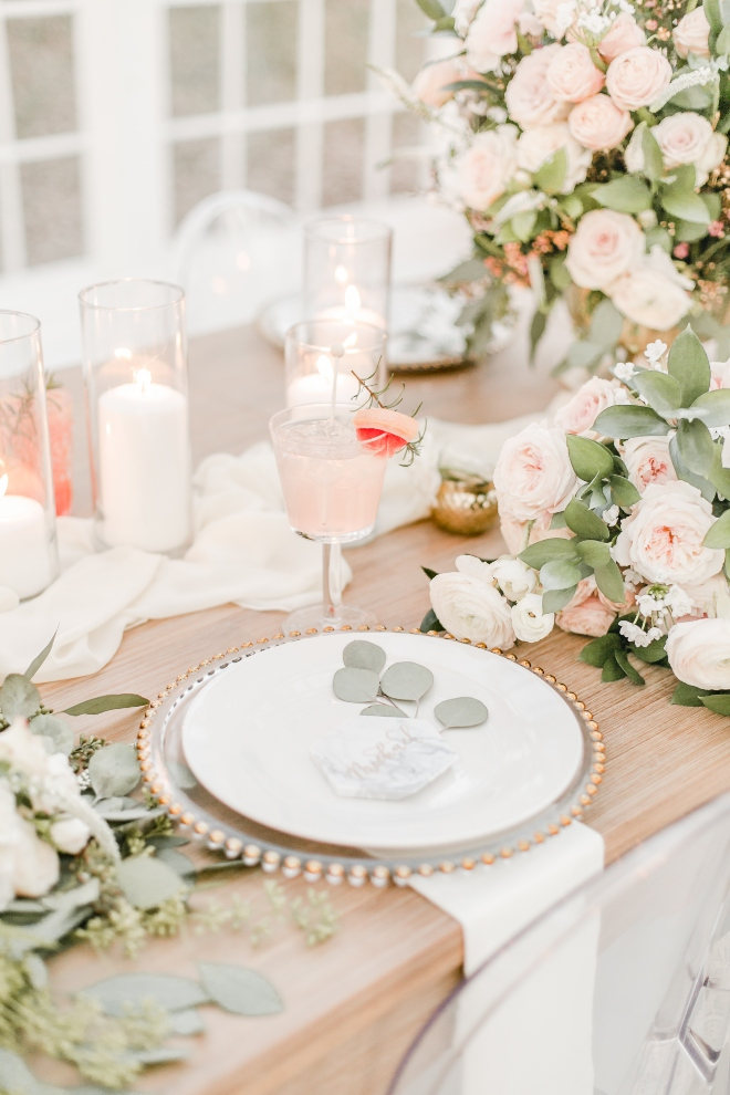farm table blush pink white greenery rose centerpiece gold beaded charger natural light wedding photography amy maddox