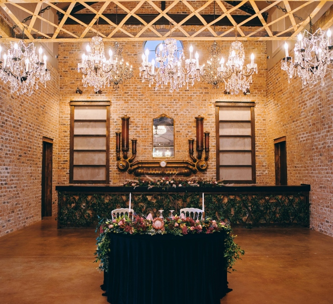 sweetheart table iron manor wedding venue chandeliers civic photos