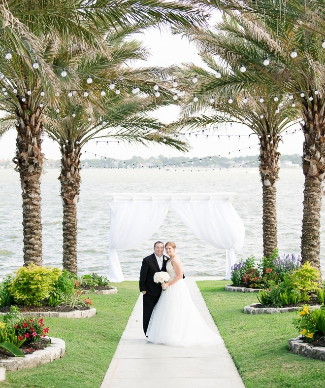 waters edge venue clear lake houston lawn palm trees waterfront ceremony