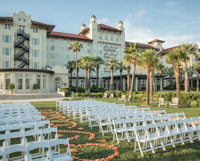 galveston wedding venue hotel galvez centennial green lawn ceremony white chairs