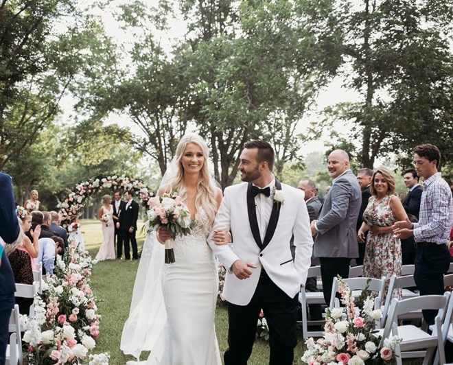 new wedding venue estates pecan park tomball houston texas outdoor ceremony pecan trees flower arch