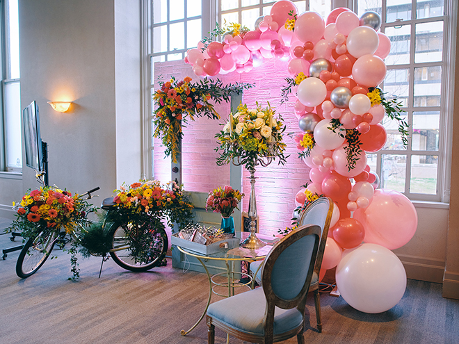 haute flowers, balloon arch, garden wedding, spring theme, bicycle, bright flowers