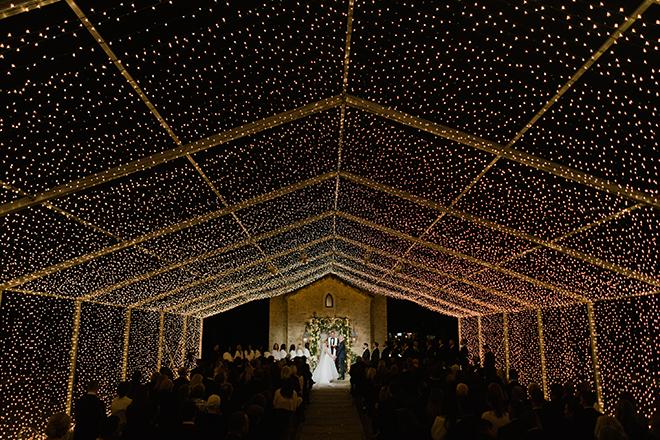 astros new year's eve wedding outdoor ceremony golden string lights