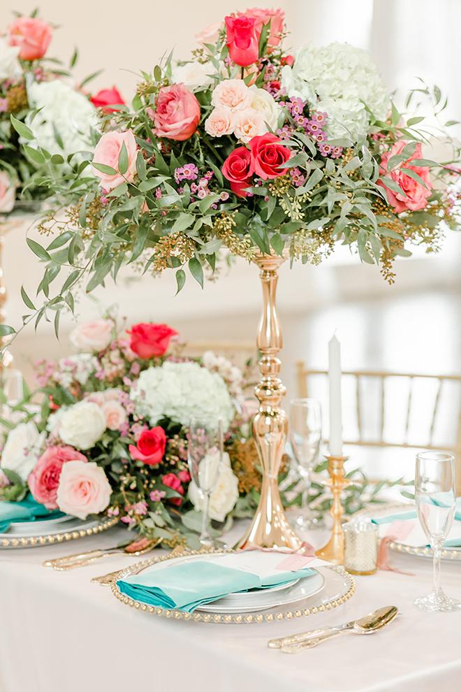 gold centerpieces, pink, blush, aqua napkins, pink linens, gold accents