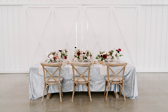 blue linen, velvet linen, floral centerpieces, french bistro chairs, cross back wood chairs, reception decor, wedding, vintage chic, country, farmhouse, texas wedding