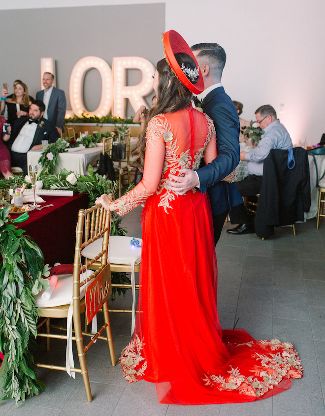 reception entertainment, marquee letters, Vietnamese dress, red