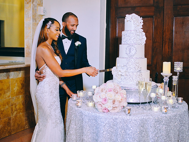 cutting the cake, reception entertainment, wedding moments, civic photos, wedding cake, classic, timeless, white, floral, silver, 5-tier