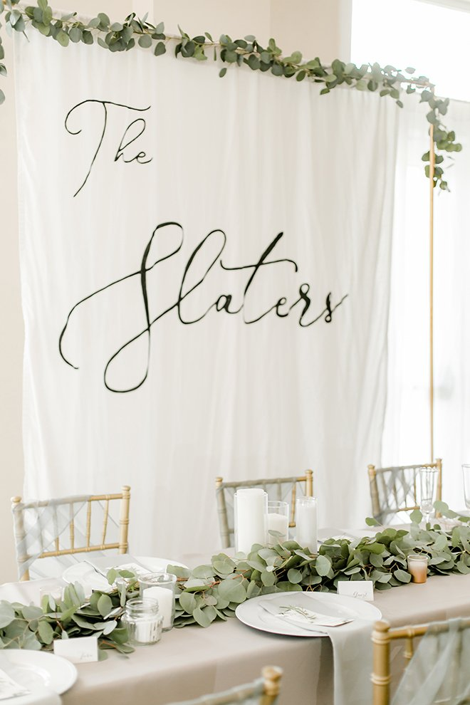 reception decor, grey, gold, white, eucalyptus, backdrop, cloth, candles, simple, elegant