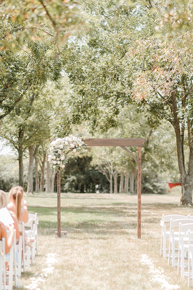 outdoor ceremony, bridal bouquet, bride, groom, estates at pecan park, white, grey, timeless, simple, wooden altar