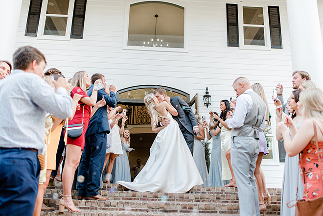 sendoff, grand exit, bubbles, day time, estates at pecan park, amy maddox photography