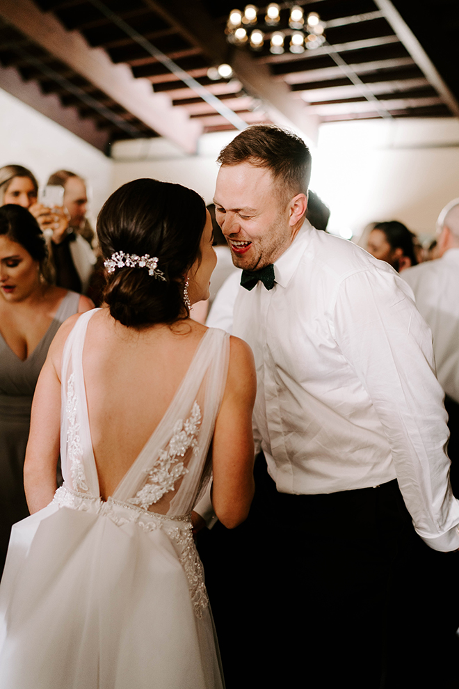 reception entertainment, bride, groom, bridal hair, bun, updo, backless bridal gown, dance, dancing