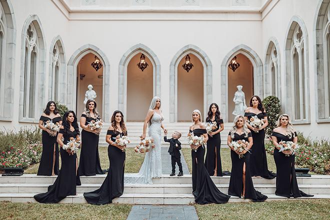 bridesmaids, bridal party, bride, black bridesmaids dresses, french venue, kid in wedding, ivory, terracotta, bouquet