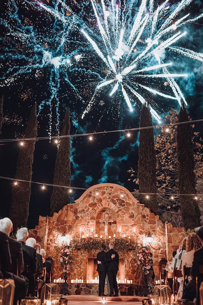 outdoor ceremony, twinkle lights, candes, carpet runner, madera estates, ama by aisha, same sex wedding, gay wedding, lgbt, real wedding, fireworks, spanish-inspired wedding, vintage