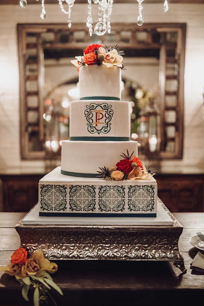 wedding cake, blue, white, flower accents, four tier, spanish tile, monogrammed, unique