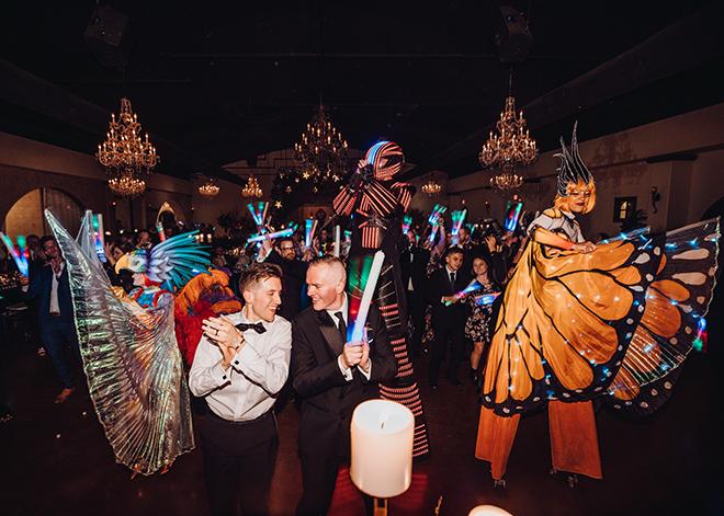 reception entertainment, performers, light up foam sticks, la horra loca, stilts, unique