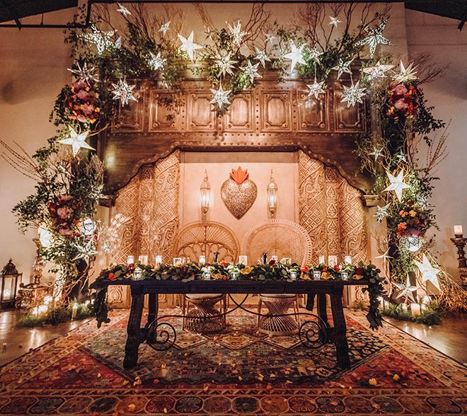 reception decor, couple's table, greenery, red, orange, yellow, flowers, metal, spanish-inspired wedding, stars, madera estates