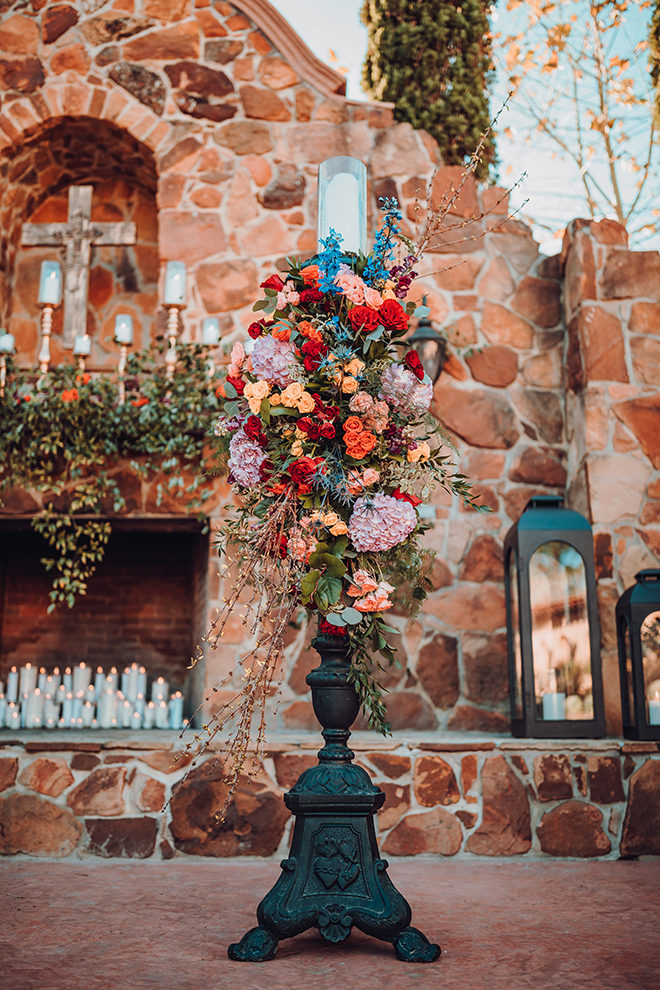 ceremony decor, flowers, outdoor ceremony, red, yellow, blue, saffron, flowers, madera estates, candles