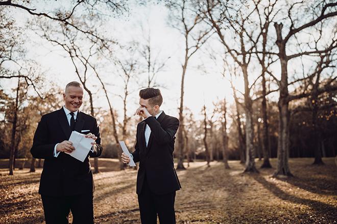 reading vows, wedding photography, wedding moments, groom, grooms, groom suit, black tie, black bowtie, madera estates, ama by aisha, same sex wedding, gay wedding, lgbt, real wedding