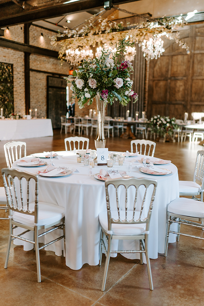 white linens, floral centerpieces, tall, chiavari chairs, silver, blush, burgundy, roses, reception decor, iron manor