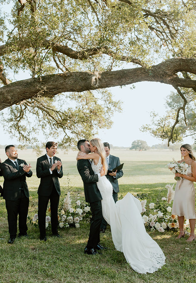 outdoor ceremony, simple, kiss, bride, groom, black, white, champagne