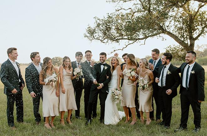 wedding party, fun wedding photos, bridesmaids, groomsmen, bride, groom, champagne, white, ivory