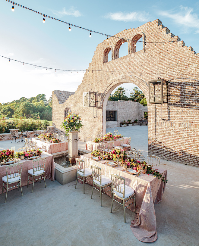 rehearsal dinner decor, table setting, outdoor, courtyard, floral centerpieces, gold flatware, gold chargers, beautiful, vibrant, unique, peach linens, iron manor, kirksey gregg productions, ama by aisha