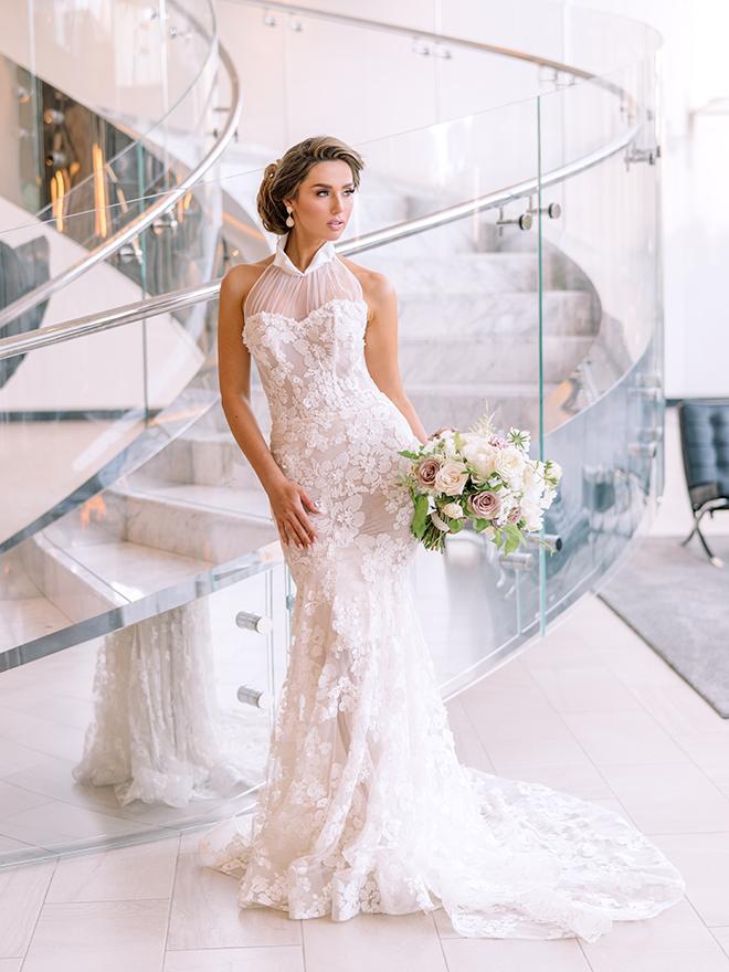 bridal portrait, halter bridal gown, galia lahav, misty rockwell artistry, bridal hair, bridal makeup, updo, natural, blush, white, ivory, bridal bouqet, post oak hotel, marble stairs, luxury wedding, editorial, inspiration