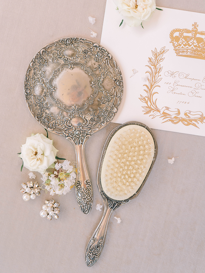something gold, brush, mirror, victorian, silver, luxury, flat lay, ivory, roses, cluster earrings, pearls, diamonds