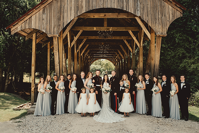 wedding party, bride, groom, bridal party, blue bridesmaids dresses, marines, big sky barn