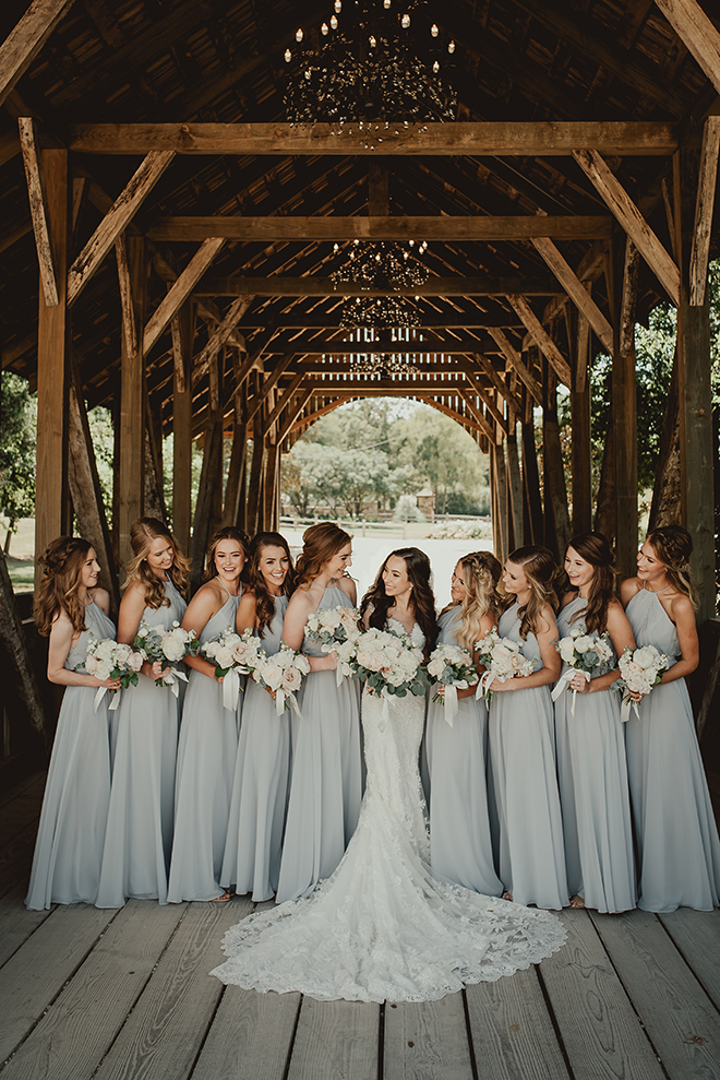 wedding party, bride, bridal party, blue bridesmaids dresses, big sky barn, bride tribe