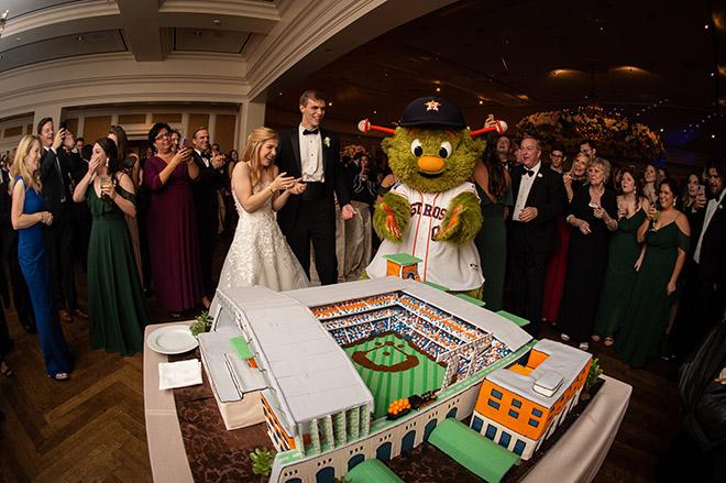 groom's cake, susie's cakes, cutting the cake, reception entertainment, astros mascot, orbit, astros stadium, minute maid park, baseball theme