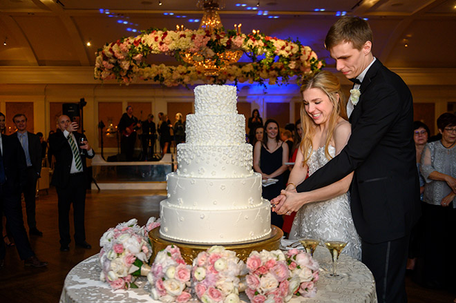 white wedding cake, floral accents, five tiers, susie's cakes, elegant, cutting the cake, reception entertainment