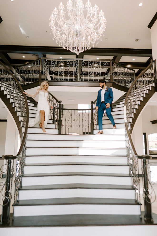 Chandelier, staircase, contemporary, white, navy, gown, elegant, interior, venue