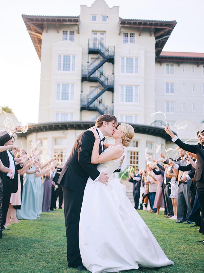 streamers, send off, bride, groom, grand exit, hotel galvez, daytime wedding