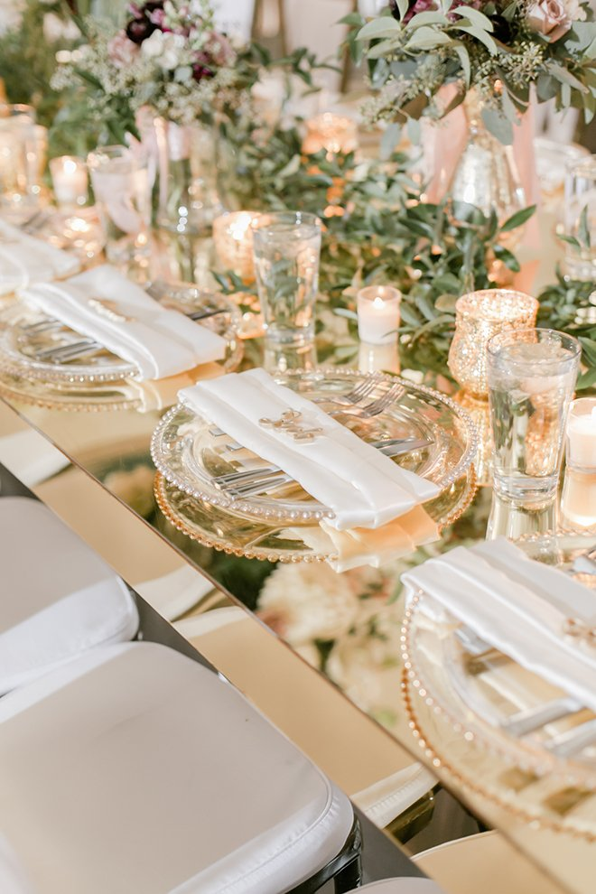reception decor, greenery runner, floral centerpieces, gold place setting, candles, romantic, flowers, tall centerpieces