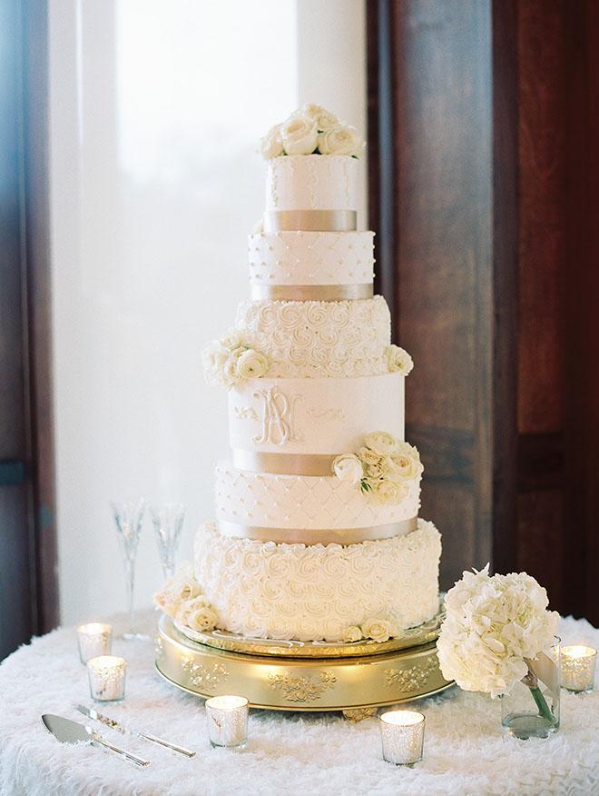 Timeless And Elegant, white cake, floral decor, candle decor, bridal cake, six tier cake