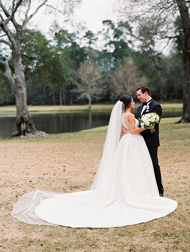 outdoor photo, the woodlands country club, bridal bouquet, white flowers, tuxedo, bridal veil