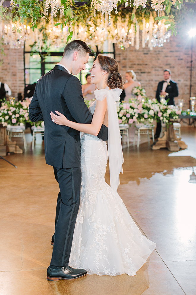 first dance, white roses, greenery, iron manor, plants n petals, plants n petals, reception decor, ceiling decor, hanging flowers, hanging greenery