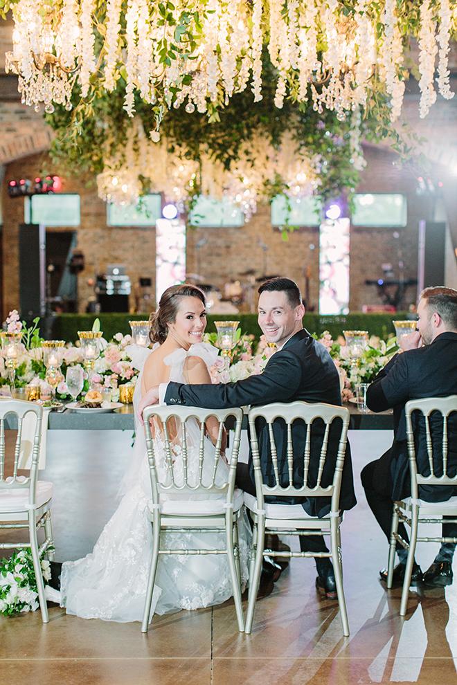 white roses, greenery, iron manor, plants n petals, plants n petals, reception decor, ceiling decor, flower garland, greenery garland, wedding table
