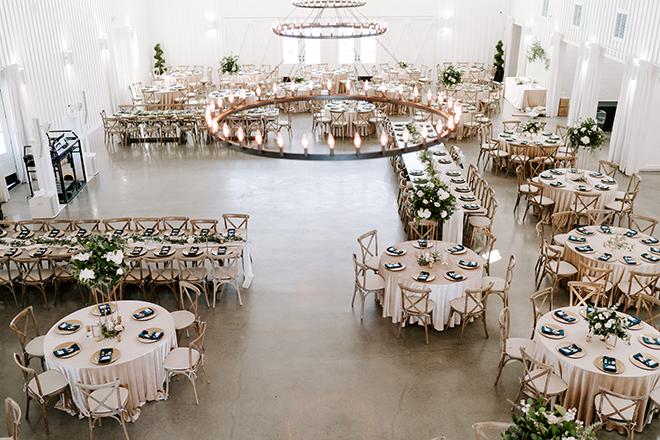 chic wedding, navy, gold, champagne, farm wedding venue, farmhouse, linens, floral centerpieces,