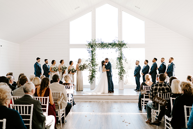 chic wedding, ceremony, decor, simple, greenery, arch, altar, indoor, emily figurelli photography, white