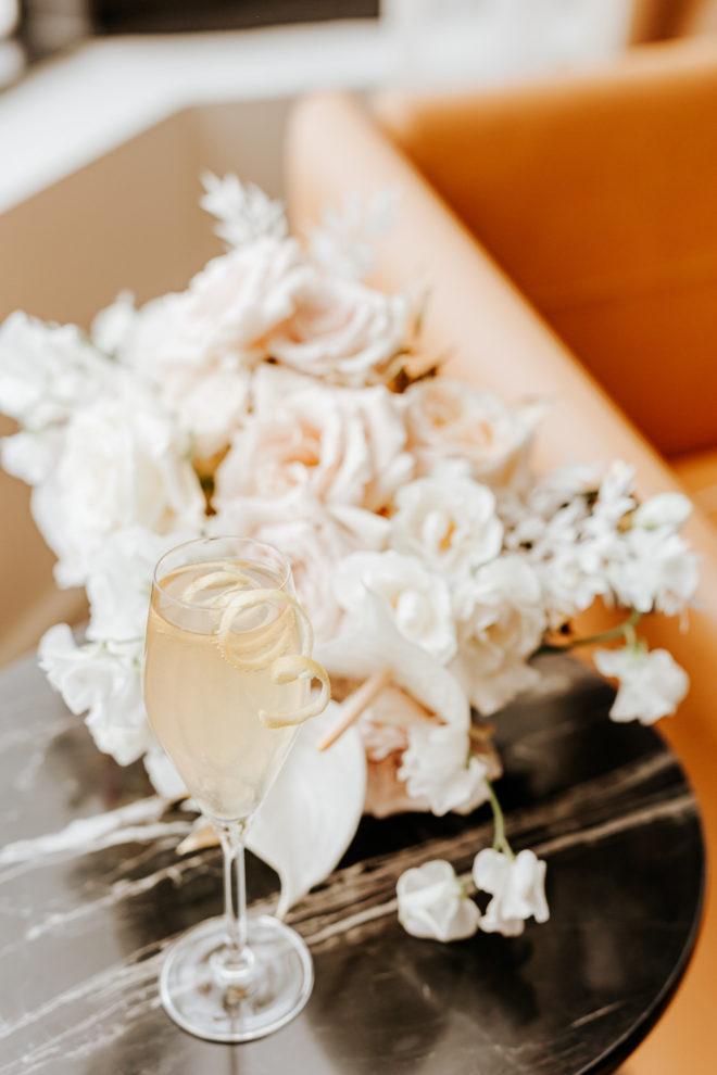 signature drink, bouquet, marble, suite, Four Seasons Hotel Houston, orange, champagne flute, roses, blush, white, wedding details