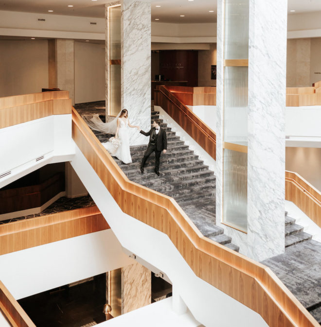 Four Seasons Hotel, downtown Houston, interior, staircase, marble, blonde wood, renovated, gray, neutrals, urban cool, bride and groom, veil, train, wedding photography ideas